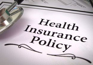A health insurance policy document with a stethoscope